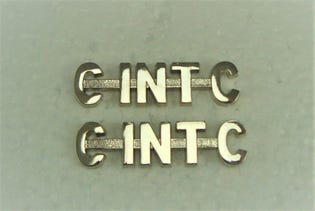 Canadian Intelligence Corps (C INT C) Metal Shoulder Title-English